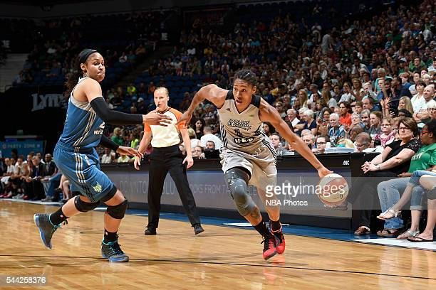 Alex Montgomery of the San Antonio Stars drives to the basket against the Minnesota Lynx on July 2 2016 at Target Center in Minneapolis Minnesota...