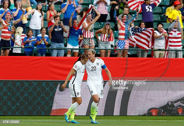 Alex Morgan and Abby Wambach of the United States celebrate after Morgan scores her first goal against goalkeeper Stefany Castano of Colombia in the...