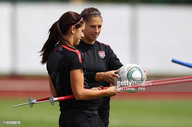 Alex Morgan and Carli Lloyd of the USA during the USA team training session held at the Rebstock training ground on July 15 2011 in Frankfurt am Main...