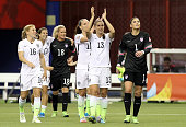 Alex Morgan and Hope Solo of the United States celebrate the 20 victory against Germany in the FIFA Women's World Cup 2015 SemiFinal Match at Olympic...