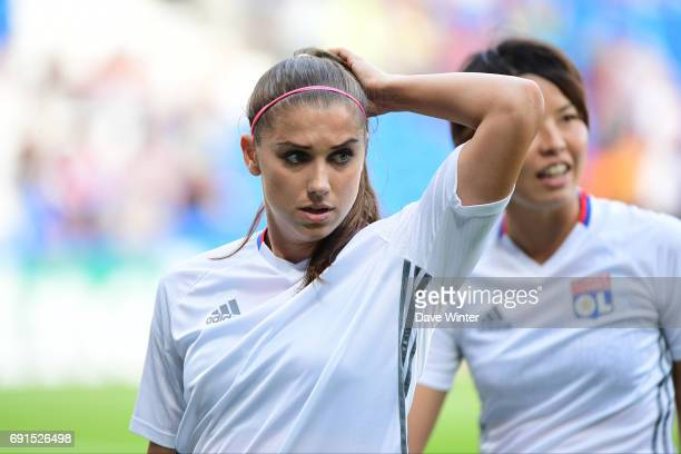 Alex Morgan and Saki Kumagai of Lyon warm up before the final of the UEFA Women's Champions League match between Olympique Lyonnais and Paris...