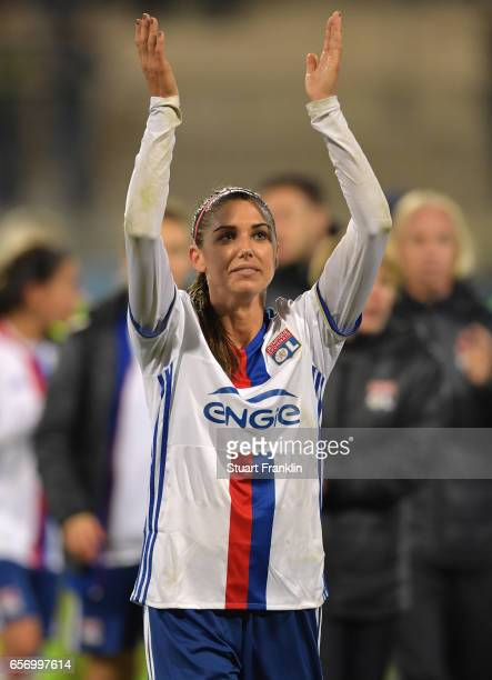 Alex Morgan of Lyon celebrates at the end of the UEFA Women's Champions League Quater Final first leg match between VfL Wolfsburg and Olympique Lyon...