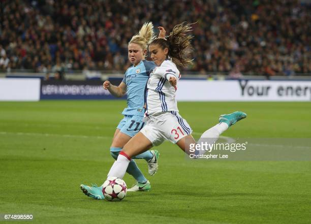 Alex Morgan of Olympique Lyon battles with Isobel Christiansen of Manchester City during the UEFA Women's Champions League Semi Final second leg...