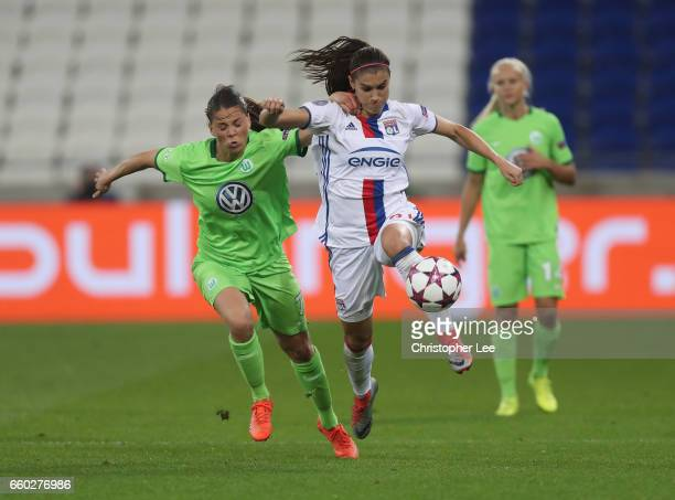 Alex Morgan of Olympique Lyon battles with Sara Bjork Gunnarsdottir of VFL Wolfsberg during the Women's Champions League match between Lyon and...