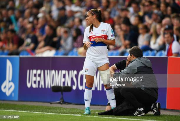 Alex Morgan of Olympique Lyonnais is given assistance during the UEFA Women's Champions League Final between Lyon and Paris Saint Germain at Cardiff...