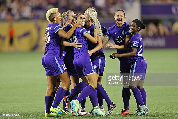 Alex Morgan of Orlando Pride celebrates her goal with her teammates against the Houston Dash during a NWSL soccer match at the Orlando Citrus Bowl on...