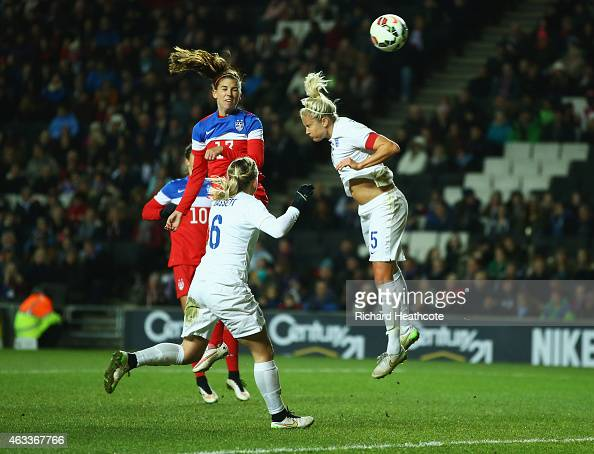 Alex Morgan of the United States beats Steph Houghton of England to score their first goal with a header during the Women's Friendly International...