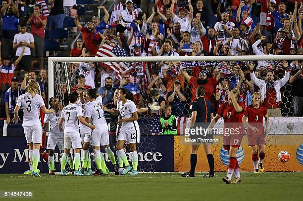 Alex Morgan of the United States celebrates a goal during a match against Germany in the 2016 SheBelieves Cup at FAU Stadium on March 9 2016 in Boca...