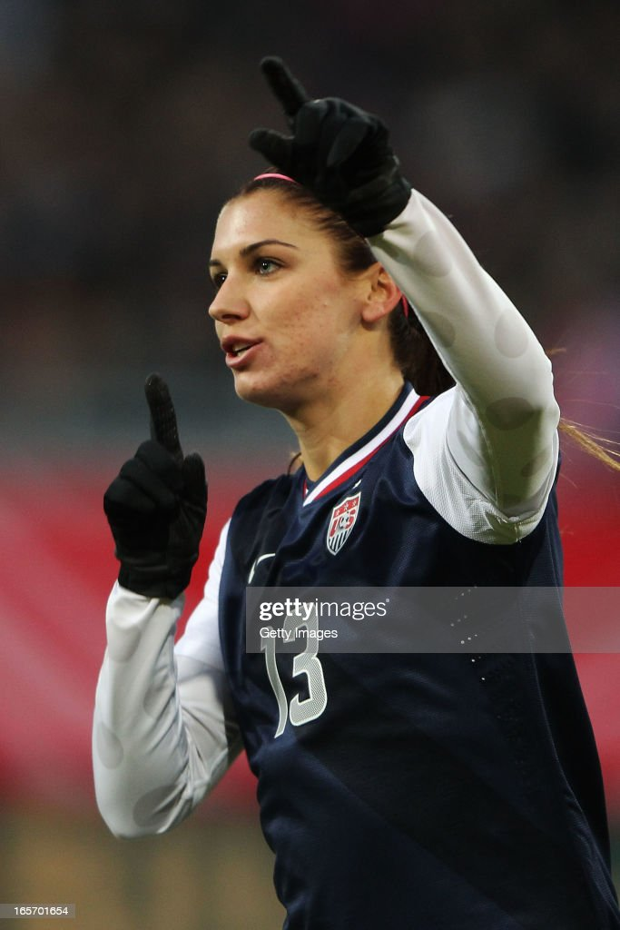 <a gi-track='captionPersonalityLinkClicked' href=/galleries/search?phrase=Alex+Morgan+-+Soccer+Player&family=editorial&specificpeople=1057310 ng-click='$event.stopPropagation()'>Alex Morgan</a> of the United States celebrates after scoring her team's third goal during the Women's International Friendly match between Germany and the United States at Sparda-Bank-Hessen-Stadion on April 5, 2013 in Offenbach, Germany.