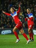 Alex Morgan of the United States celebrates as she score their first goal during the Women's Friendly International match between England and USA at...