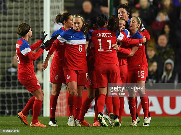Alex Morgan of the United States celebrates with team mates as she scores their first goal during the Women's Friendly International match between...