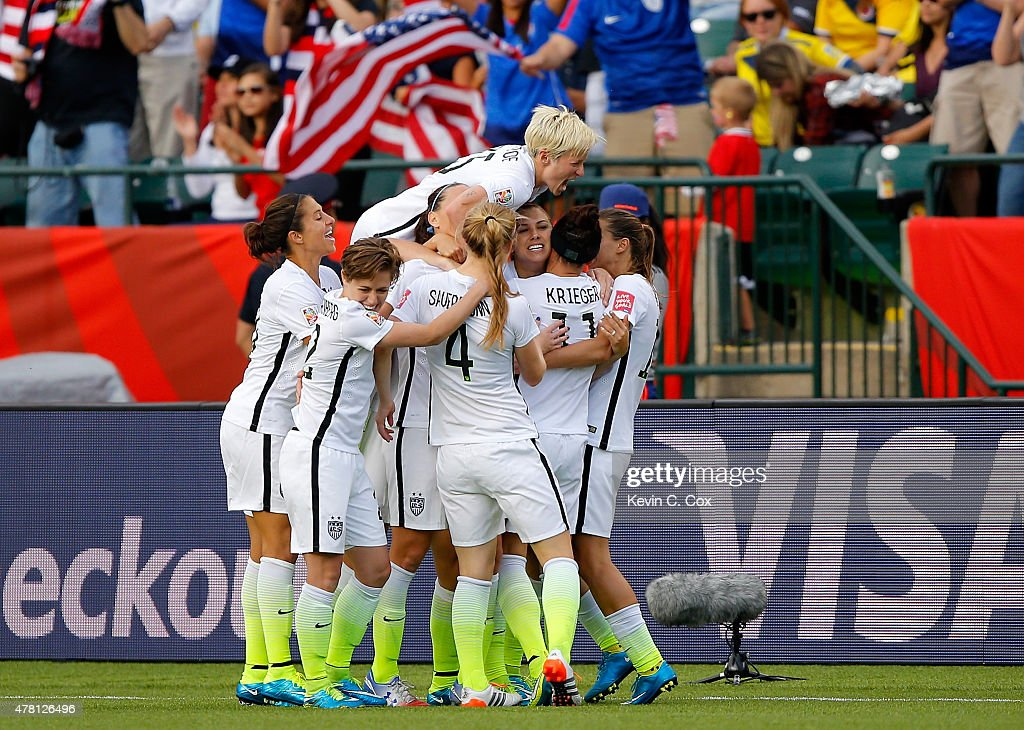 Alex Morgan #13 of the United States celebrates with teammates after Morgan scores her first goal against goalkeeper Stefany Castano #1 of Colombia in the second half in the FIFA Women's World Cup 2015 Round of 16 match at Commonwealth Stadium on June 22, 2015 in Edmonton, Canada.