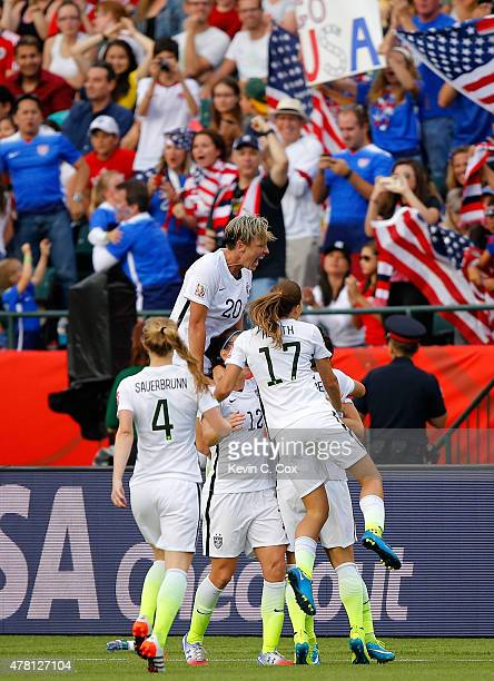 Alex Morgan of the United States celebrates with teammates after Morgan scores her first goal against goalkeeper Stefany Castano of Colombia in the...