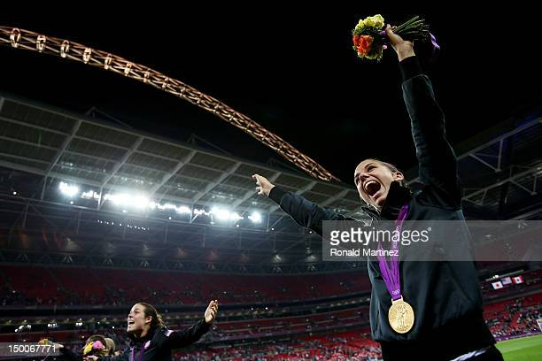 Alex Morgan of the United States celebrates with the the gold medal after defeating Japan by a score of 21 to win the Women's Football gold medal...