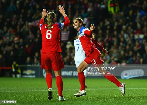 Alex Morgan of the United States celebrates with Whitney Engen as she scores their first goal during the Women's Friendly International match between...