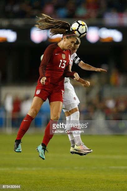 Alex Morgan of the United States competes for the ball against Jessie Fleming of Canada during a friendly match at Avaya Stadium on November 12 2017...