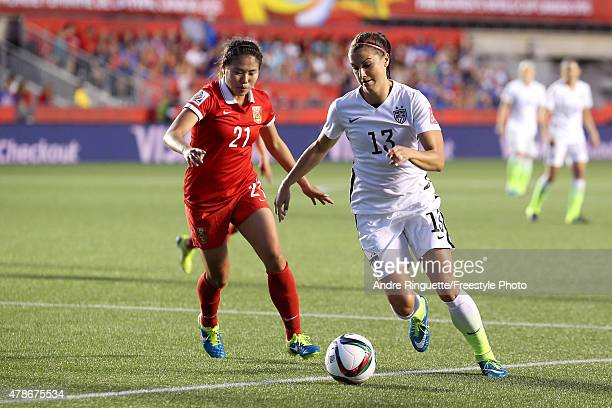 Alex Morgan of the United States controls the ball against Wang Lisi of China in the second half in the FIFA Women's World Cup 2015 Quarter Final...