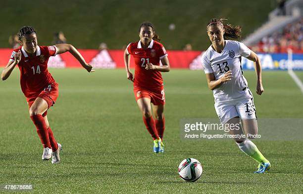 Alex Morgan of the United States controls the ball against Zhao Rong and Wang Lisi of China in the second half in the FIFA Women's World Cup 2015...