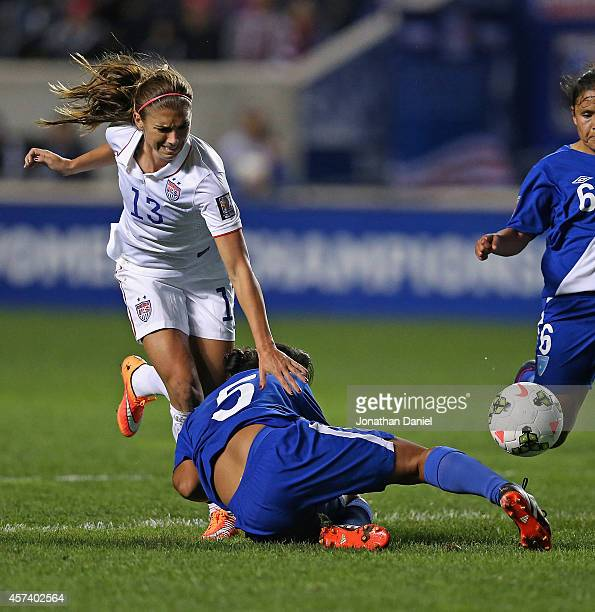 Alex Morgan of the United States crashes into Londy Barrios of Guatemala during the 2014 CONCACAF Women's Championship at Toyota Park on October 17...