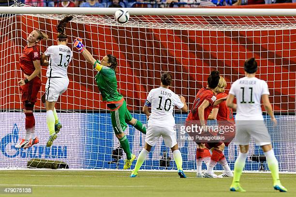 Alex Morgan of the United States goes up for a header against goalkeeper Nadine Angerer of Germany in the first half in the FIFA Women's World Cup...