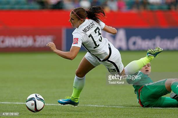 Alex Morgan of the United States is tripped by goalkeeper Catalina Perez of Colombia leading to a red card for Perez in the second half in the FIFA...
