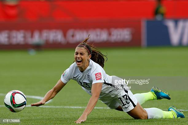 11da8f4e2 Alex Morgan of the United States is tripped by goalkeeper Catalina Perez of  Colombia leading to