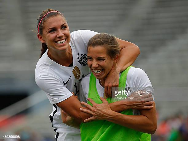 Alex Morgan of the United States of America leaps on the back of Tobin Heath at halftime against Haiti during the US Women's 2015 World Cup victory...