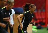 Alex Morgan of the United States of America stretches during a training session prior to the FIFA Women's World Cup Canada 2015 Final between United...