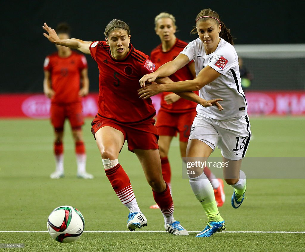 Alex Morgan of the United States runs with the ball ahead of Annike Krahn of Germany in the first half in the FIFA Women's World Cup 2015 SemiFinal...