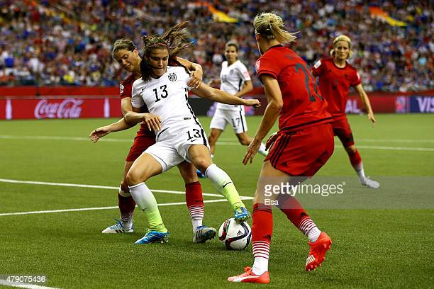 Alex Morgan of the United States with the ball against Simone Laudehr Annike Krahn and Lena Goessling of Germany in the first half in the FIFA...