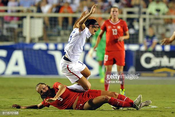 Alex Morgan of the US women's national team collides with Lia Walti of the Swiss women's national team at WakeMed Soccer Park on August 20 2014 in...