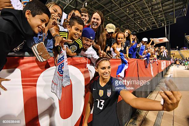 Alex Morgan of the US Women's National Team takes a selfie with fans after the game against Thailand on September 15 2016 at MAPFRE Stadium in...