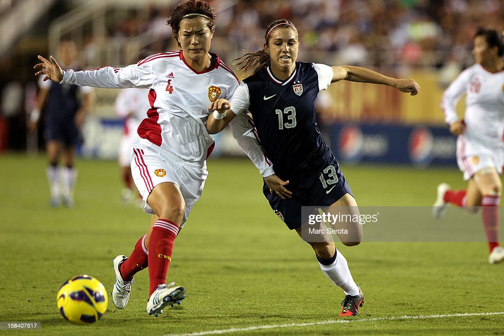 Alex Morgan #13 of the USA battles for the ball againstLi Jaiyue #4 of China at FAU Stadium on December 15, 2012 in Boca Raton, Florida.