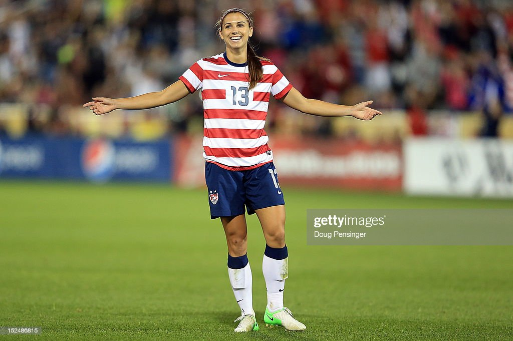 <a gi-track='captionPersonalityLinkClicked' href=/galleries/search?phrase=Alex+Morgan+-+Soccer+Player&family=editorial&specificpeople=1057310 ng-click='$event.stopPropagation()'>Alex Morgan</a> #13 of the USA celebrates her goal against Australia at Dick's Sporting Goods Park on September 19, 2012 in Commerce City, Colorado. The USA defeated Australia 6-2.
