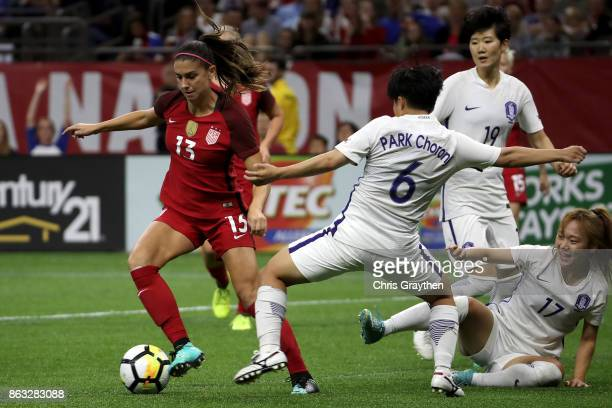 Alex Morgan of the USA fights for the ball with Chorong Park of the Korea Republic at the MercedesBenz Superdome on October 19 2017 in New Orleans...