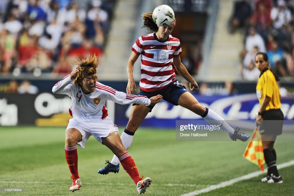 Alex Morgan #13 of the USA heads the ball over Li Jiayue #4 of China at PPL Park on May 27, 2012 in Chester, Pennsylvania. USA won 4-1.