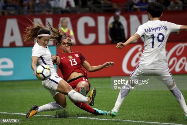 Alex Morgan of the USA scores a goal over Sohyun Cho of the Korea Republic at the MercedesBenz Superdome on October 19 2017 in New Orleans Louisiana