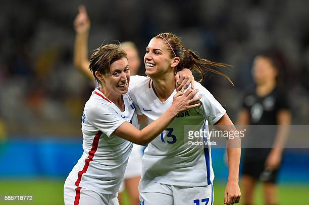 Alex Morgan of United States and teammate Meghan Klingenberg celebrate after Morgan scores in the Women's Group G first round match between the...