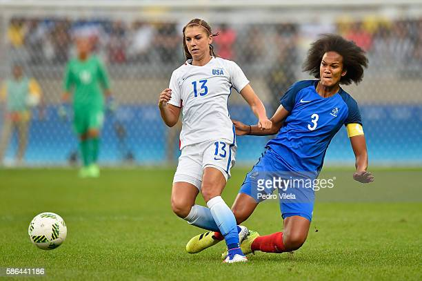 Alex Morgan of United States battles for the ball against Wendie Renard of FraFrance during the Women's Group F first round match between United...