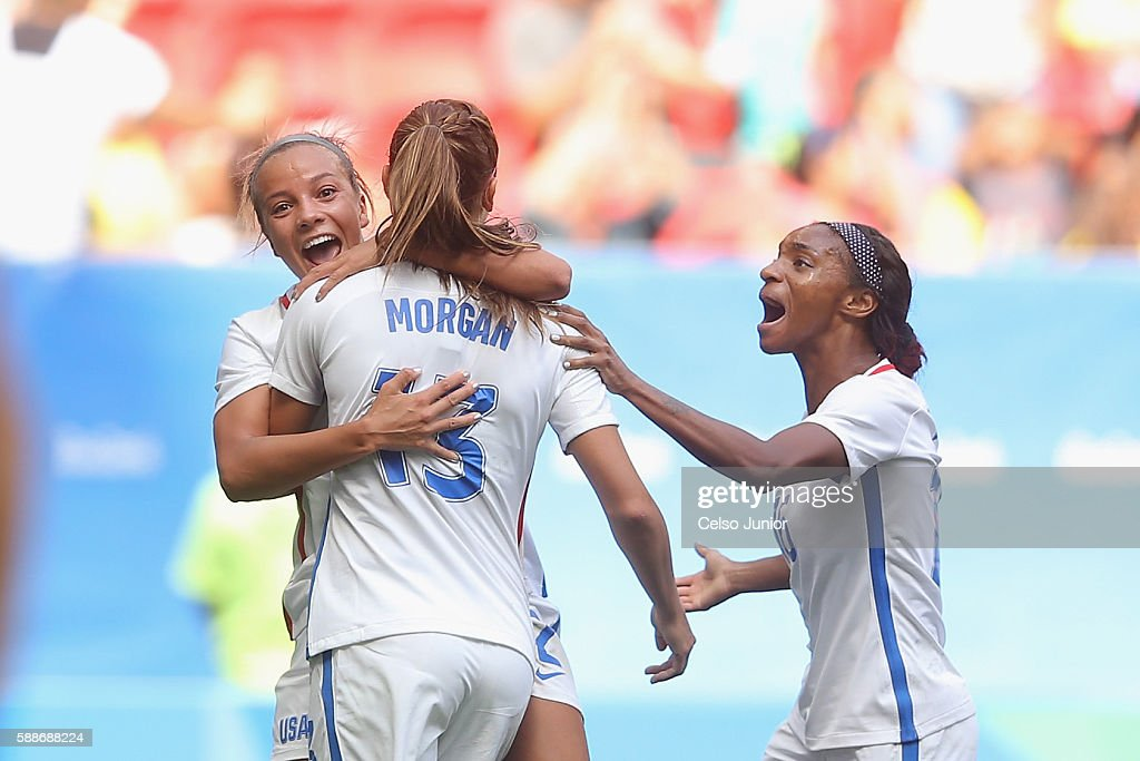 Alex Morgan of United States celebrates her goal to tie the game with teammates Mallory Pugh and Crystal Dunn in the second half against Sweden...