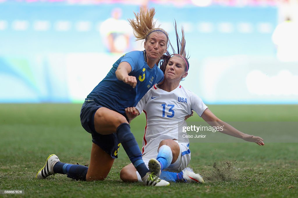 Alex Morgan of United States collides with Linda Sembrant of Sweden after shooting to score and tie the game in the second half during the Women's...