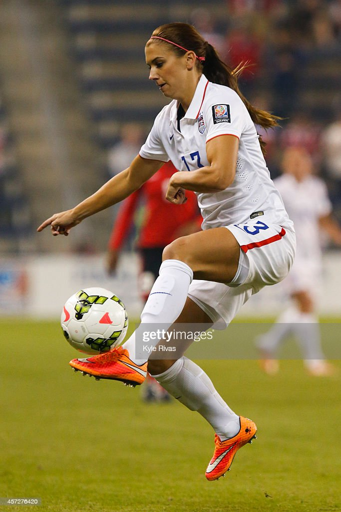 Trinidad (CO) United States  city pictures gallery : Alex Morgan #13 of United States controls a pass while moving up field ...