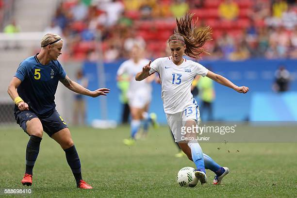 Alex Morgan of United States controls the ball against Nilla Fischer of Sweden during the Women's Football Quarterfinal match at Mane Garrincha...