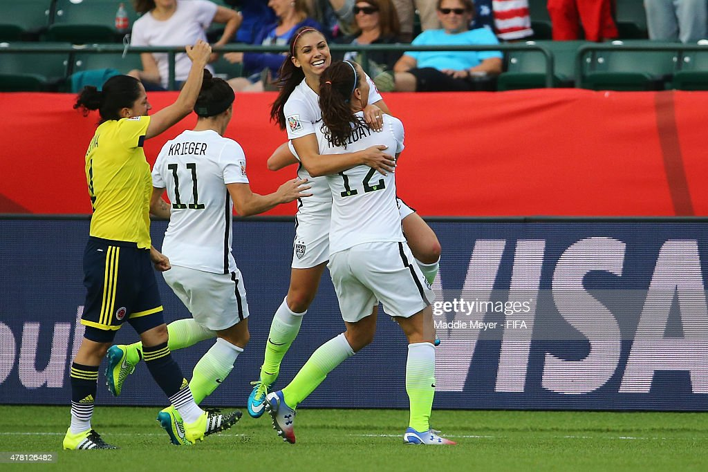 <a gi-track='captionPersonalityLinkClicked' href=/galleries/search?phrase=Alex+Morgan+-+Soccer+Player&family=editorial&specificpeople=1057310 ng-click='$event.stopPropagation()'>Alex Morgan</a> #13 of United States of America celebrates with Alex Krieger #11 and <a gi-track='captionPersonalityLinkClicked' href=/galleries/search?phrase=Lauren+Holiday&family=editorial&specificpeople=5504567 ng-click='$event.stopPropagation()'>Lauren Holiday</a> #12 after scoring a goal during the FIFA Women's World Cup Canada 2015 Round of 16 match between the United States and Colombia at Commonwealth Stadium on June 22, 2015 in Edmonton, Canada.