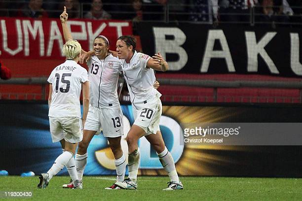 Alex Morgan of USA celebrates the first goal with Megan Rapinoe of USA and Abby Wambach of USA during the FIFA Women's World Cup Final match between...