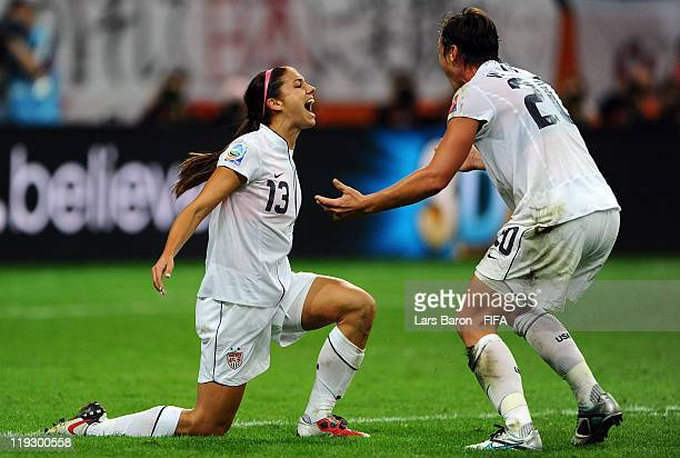 Alex Morgan of USA celebrates with team mate Abby Wambach after scoring her teams first goal during the FIFA Women's World Cup Final match between...
