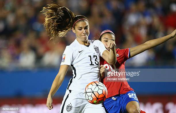 Alex Morgan of USA scores a goal in the first minute of play against Wendy Acosta of Costa Rica during the 2016 CONCACAF Women's Olympic Qualifying...