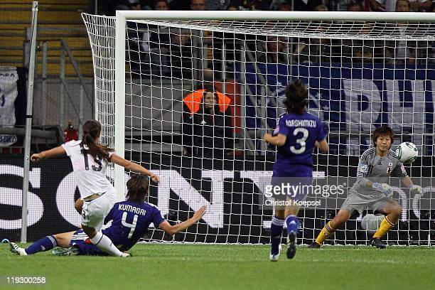Alex Morgan of USA scores the firstb goal against Saki Kumagai of Japan Azusa Iwashimizu of Japan and Ayumi Kaihori of Japan during the FIFA Women's...