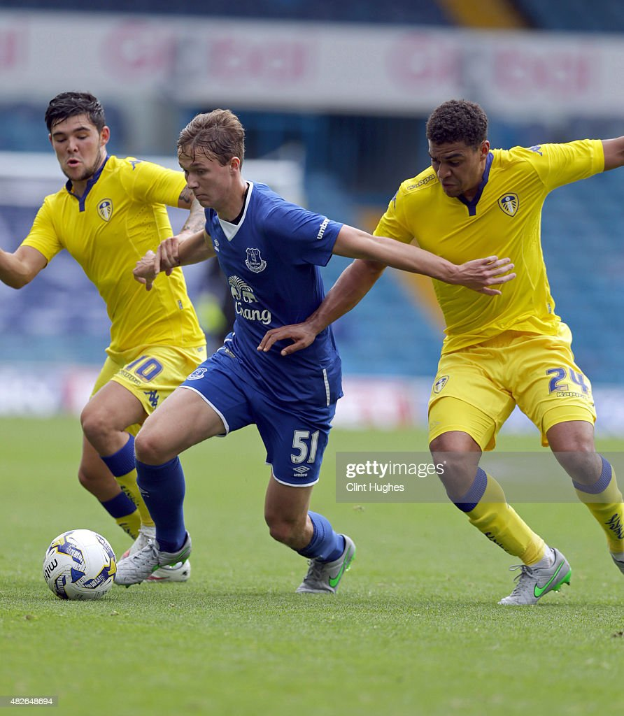 Alex Mowatt (L) and Tom Adeyemi (R) of Leeds United tackle Kieran Dowell of Everton during the Pre Season Friendly match between Leeds United and Everton at Elland Road on August 1, 2015 in Leeds, England.