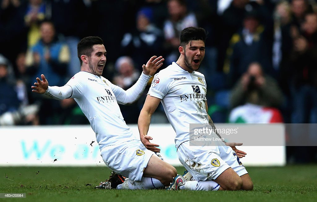 Alex Mowatt of Leeds United celebrates his goal with Lewis Cook during the Sky Bet Championship match between Leeds United and Millwall at Elland Road on February 14, 2015 in Leeds, England.